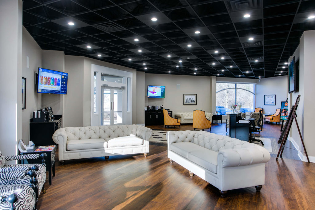 Cary Dentist office interior lobby with white leather couches and beverage stations