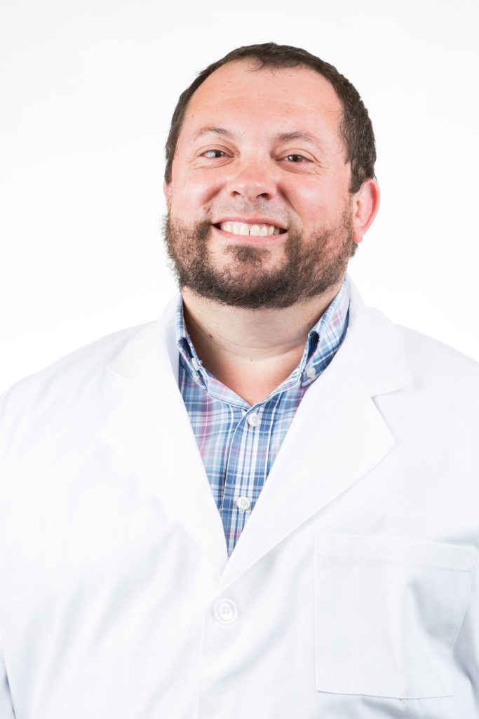 Dr. Don Bailey wearing white lab jacket
