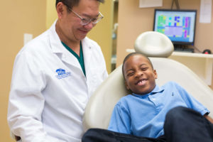 Little boy laughing at dentist