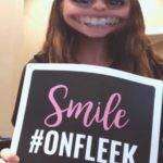 "Lane and Associates Family Dentistry employee holding up My Social Practice sign that says ""Smile #OnFleek"""