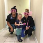 Little girl with two Lane and Associates NC Employees celebrating National Tooth Fairy Day 2018