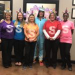 Dental office dressed up as Skittles and Unicorns with Rainbow Balloons decorating the office in Pittsboro NC
