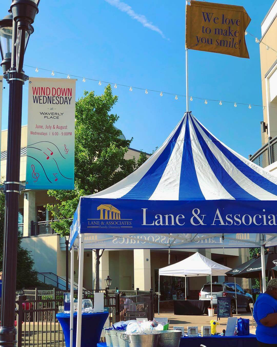 Lane and Associates Family Dentistry's Blue and White striped Tent at the Wind Down Wednesday Event in Cary