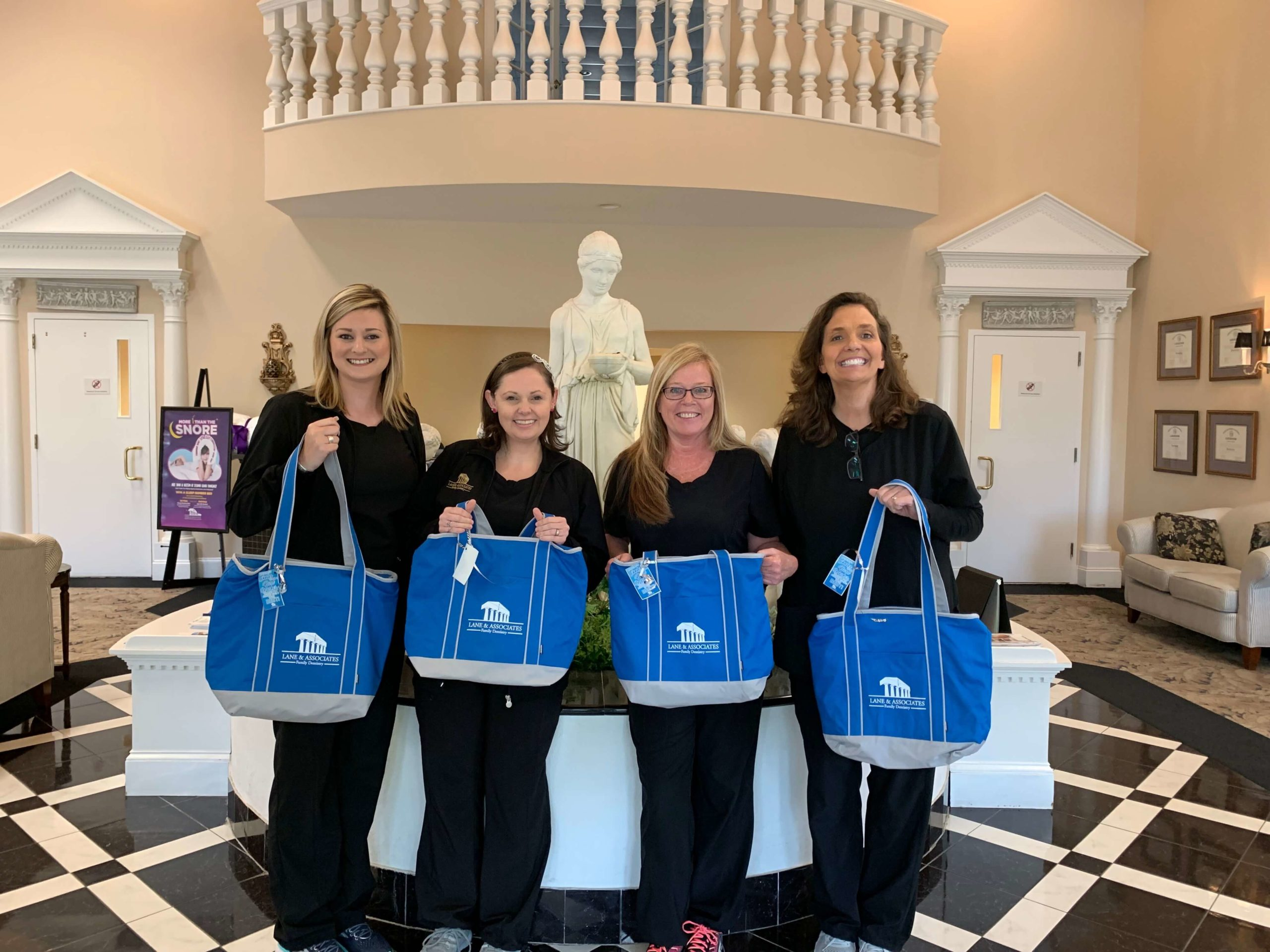 Fuquay Administrative Professionals standing with their cooler totes