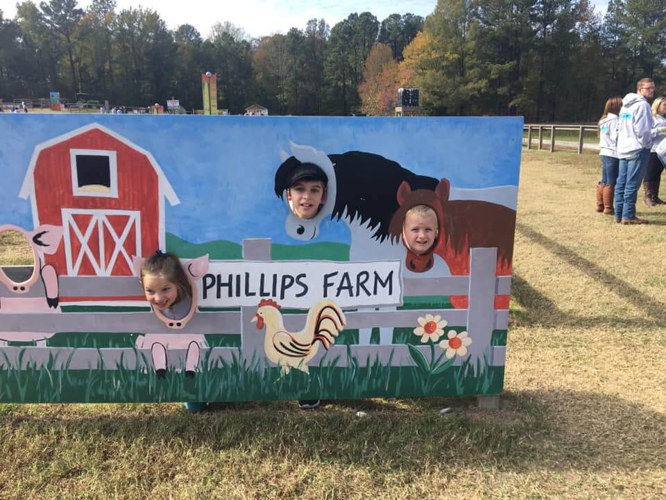 Phillips Farm Cary face in hole sign