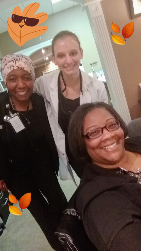 Smiling Raleigh Dental staff selfie