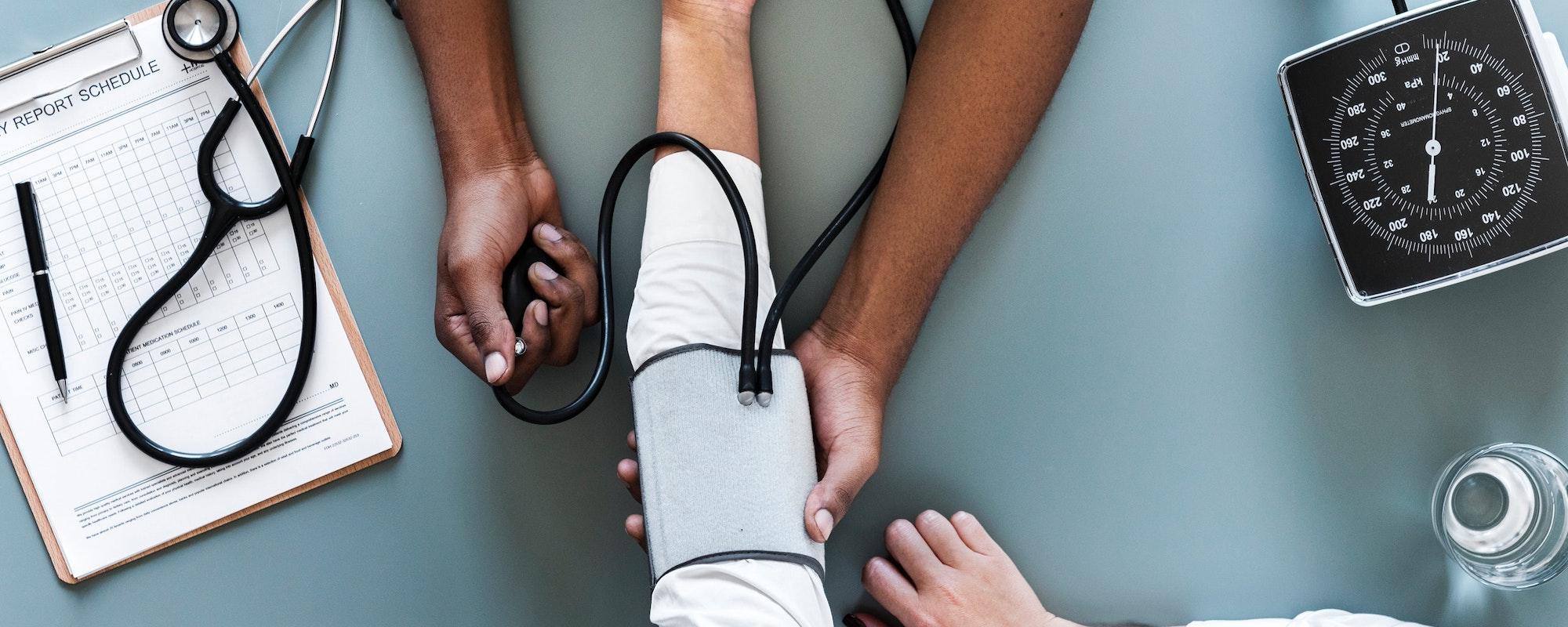 staff taking patient blood pressure
