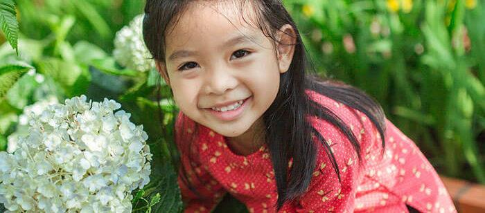 smiling little girl in garden